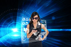Glamorous brunette using smartphone with interface Stock Photography