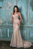 Glamorous Brunette Woman in luxury Interior. stock photo