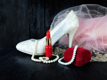 Glamorous composition made of white heels, red lipstick and pink dress Royalty Free Stock Images
