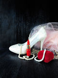 Glamorous composition made of white heels, red lipstick and pink dress Stock Photo