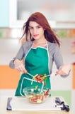Glamorous cook preparing salad Stock Image