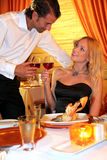 Glamorous couple cheering in restaurant Royalty Free Stock Images