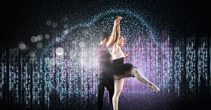 Glamorous Couple dancing with digital technology interface and glowing sparkling light stock photo