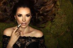 Glamorous curvy brunette woman royalty free stock image