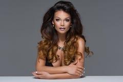 Glamorous curvy brunette woman Royalty Free Stock Photo