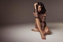 Glamorous curvy brunette woman Royalty Free Stock Photography