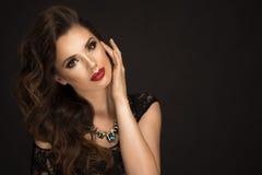 Glamorous curvy brunette woman Stock Image
