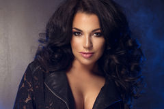 Glamorous curvy brunettewoman Stock Images