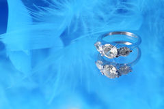 Glamorous diamond ring and blue boa Royalty Free Stock Photos