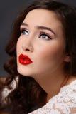 Glamorous diva. Close-up portrait of beautiful girl with classical glamorous makeup looking upwards Stock Photo