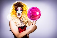 Glamorous drag queen with disco ball Royalty Free Stock Images