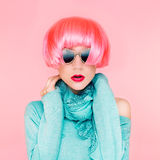 Glamorous fashion lady in pink wig. On pink background Royalty Free Stock Image