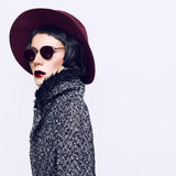 Glamorous fashion lady in a stylish coat and hat. Vintage style Stock Images