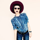 Glamorous fashion lady in a stylish jeans clothes Royalty Free Stock Photo