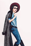 Glamorous fashion model in coat and stylish jeans clothes. Fashi Stock Photography