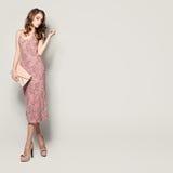 Glamorous Fashion Model Woman. Standing on Background stock photos