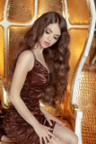 Glamorous fashionable woman with long wavy hair. Model posing on Stock Photo