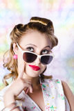 Retro glam model on colourful disco dots Stock Images