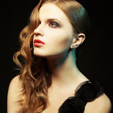 Glamorous ginger girl with perfect make up posing in black dress. Superstar concept. Glamorous ginger girl with perfect make-up posing in black dress over black Royalty Free Stock Photo