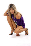 Glamorous girl. There is cute girl looks at you. She wear purple shirt and black sandals royalty free stock photos
