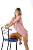 Glamorous girl on a blue chair Stock Images