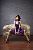 Glamorous girl on the couch Royalty Free Stock Photography