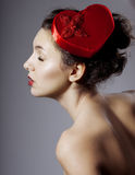Glamorous girl in an elegant hat Royalty Free Stock Photography