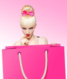 Glamorous girl with huge shopping bag on pink Stock Photo