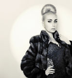 Glamorous girl in mink fur coat Royalty Free Stock Photos