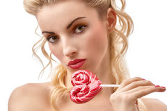 Fashion beauty portrait of nude sexy girl with heart lollipop Stock Photos
