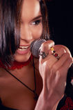 Glamorous girl singing on the stage Royalty Free Stock Images