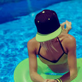 Glamorous Girl summer party in the swimming pool Stock Photos