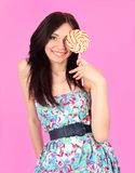 Glamorous girl wearing colorful dress with lollipo Royalty Free Stock Photography