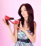 Glamorous girl wearing colorful dress with shoes Stock Photo