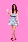 Glamorous Girl Wearing Colorful Dress With Lollipo Stock Photo