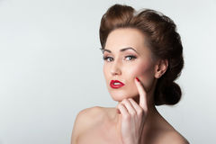 Beautiful vintage woman portrait with forties hairstyle. Glamorous graceful beautiful woman portrait with forties hairstyle - isolated on grey Royalty Free Stock Image