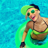 Glamorous Happy Girl hot summer party in the pool Royalty Free Stock Photo