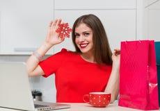 Glamorous housewife shopping online Stock Image