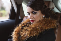 Glamorous lady in the car. Royalty Free Stock Photography