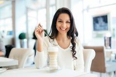 Glamorous lady drinking coffee Stock Image