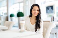 Glamorous lady drinking coffee Stock Photography