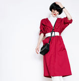 Glamorous lady in fashionable red vintage coat on a white backgr Royalty Free Stock Photos