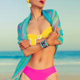 Glamorous lady in fashionable swimsuit and stylish accessories a Royalty Free Stock Images