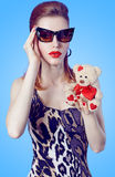Glamorous lady girl in glasses, Loving teddy bear Royalty Free Stock Photo