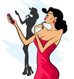 Glamorous lady in red dress and red shoes makes selfie. On her phone Stock Photo