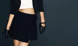 Glamorous lady in stylish leather gloves on black background roc Stock Photos