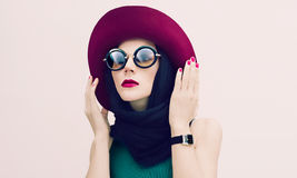 Glamorous lady in vintage hat and sunglasses trend. fashion port Stock Image