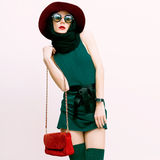 Glamorous lady in vintage trend accessories. Green and red combi Royalty Free Stock Images