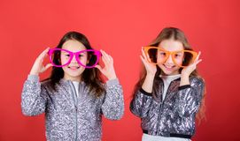 Glamorous little clubbers. Small kids in party glasses having fun. Cool party girls wearing fancy glasses. Party girls. In fashion glasses. Happy children enjoy stock images