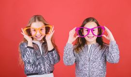 Glamorous little clubbers. Small kids in party glasses having fun. Cool party girls wearing fancy glasses. Party girls. In fashion glasses. Happy children enjoy stock photos